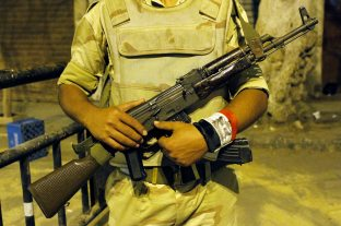 """Kirollos - 21"" Army soldier guard the modorya square and applying the curfew."
