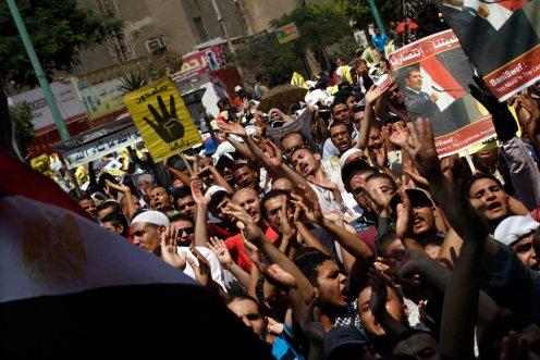 Pro legitimacy protesters shout anti military slogans.