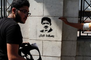 Down with the thing, says the graffiti, referring to Morsi.