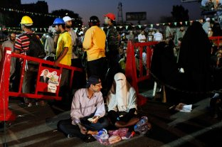 1st day of Ramadan at Rabaa, A newly married couple having their iftar.